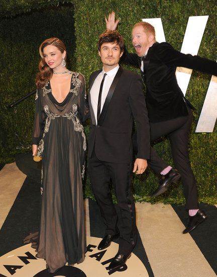 Miranda Kerr, Orlando Bloom, and Jesse Tyler Ferguson at the 2013 Vanity Fair Oscar party.