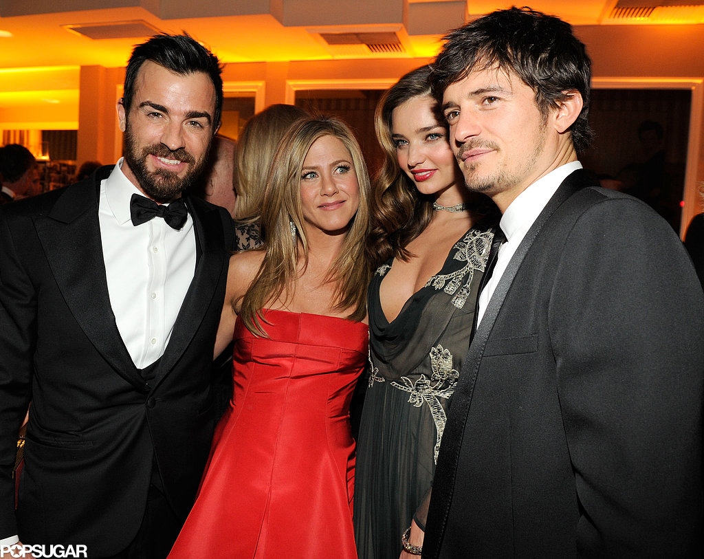 Justin Theroux, Jennifer Aniston, Miranda Kerr and Orlando Bloom posed for a couples' picture at the Vanity Fair Oscars party.