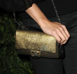 Alicia Vikander's gold metallic Chanel bag provided a dose of evening glamour to her more laid-back styling.