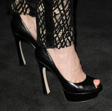 She completed her darker look with a slick pair of peep-toe pumps.