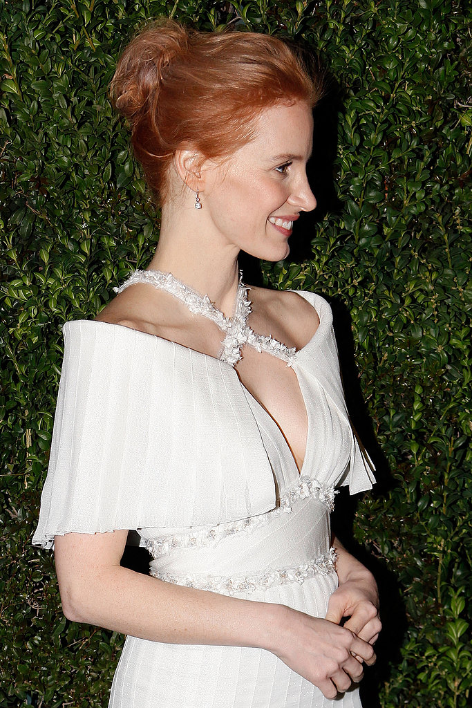 From the side, you can take in the delicate details of Jessica Chastain's pleated white Chanel dress, including the embellished crisscross neckline.