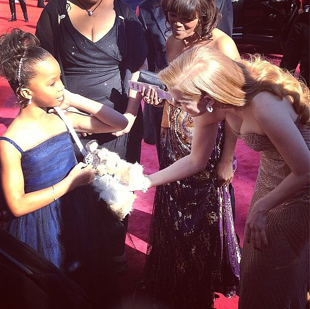Quvenzhané Wallis showed her purse to Jessica Chastain (in Armani Privé). Source: Instagram user theacademy