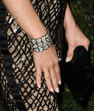 "Upon closer review, you'll see just how intricate the texture is on January Jones's black ""webbed"" pants. Lest we forget, she added a black-and-white Chanel diamond cuff into the mix too."