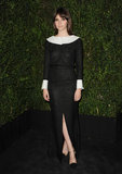 Felicity Jones covered up in a sophisticated black-and-white dress from the Chanel Spring '13 collection. We love the contrast in stark hues, but most of all, we love the sexy front slit.