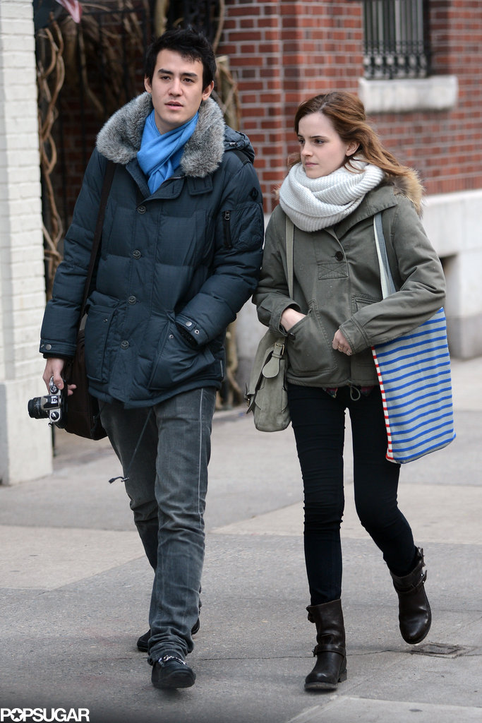 Emma Watson and Will Adamowicz bundled up against the cold.