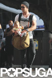 Chris Hemsworth held baby India.