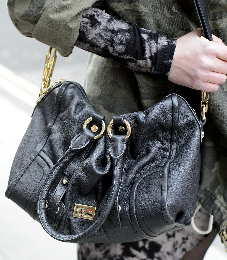 A Moschino satchel was the perfect accompaniment to printed jeans and a camouflage jacket.