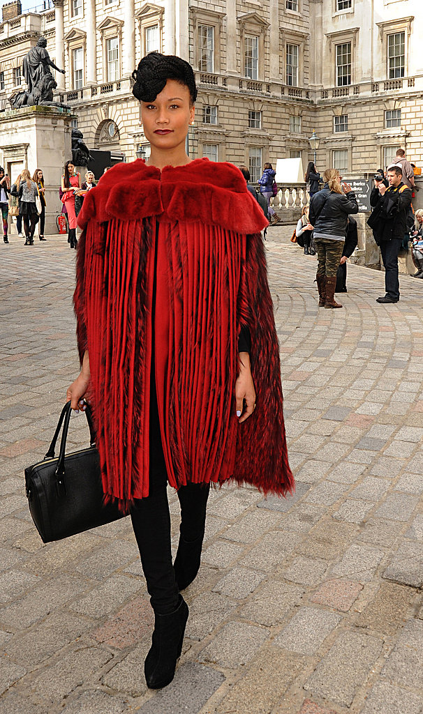 A statement-red fur was a little more grand than your average showgoer's ensemble.