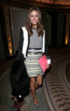 Olivia mixed prints like a pro in a geometric-print sweater, pleated Milly skirt, colorblock Tibi blazer, and red-trim pumps at the Temperley London show in London.