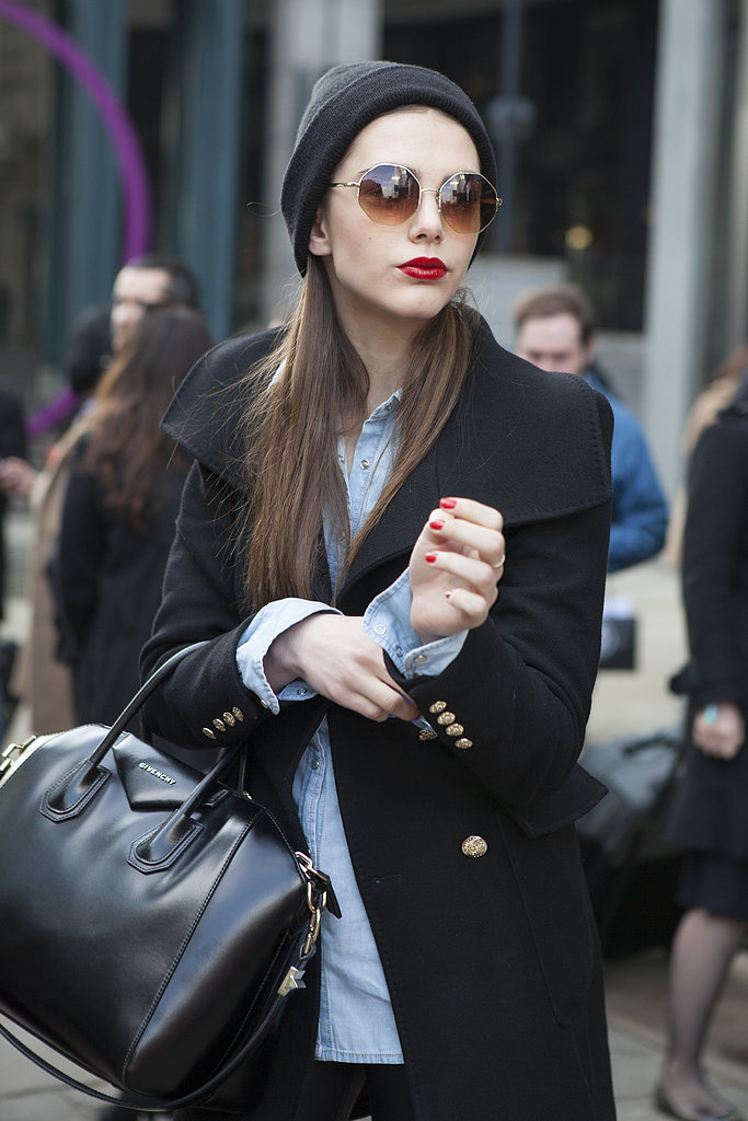 A model showed off her red lips and coordinating crimson manicure between shows.