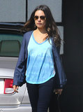 Mila Kunis wore a blue tie-dye top.