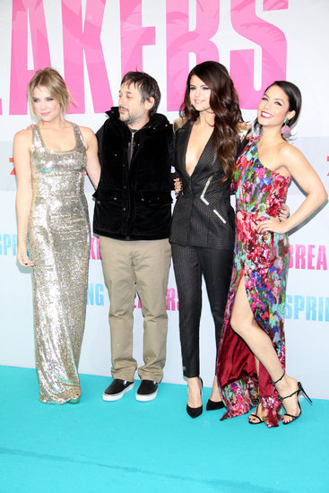 Vanessa Hudgens, Selena Gomez, and Ashley Benson posed with director Harmony Korine.