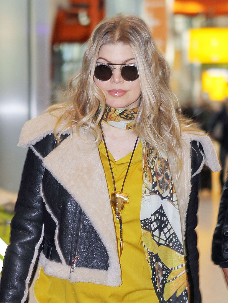Fergie wore round sunglasses.