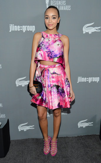 Ashley Madekwe's pink floral J. Mendel crop top and A-line skirt splashed the gray carpet with major color. Matching strappy hot-pink sandals and a black clutch completed her eye-catching style.