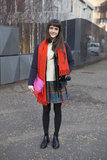 A colorblocked Gap clutch only furthered the flair of her bold-printed skirt.