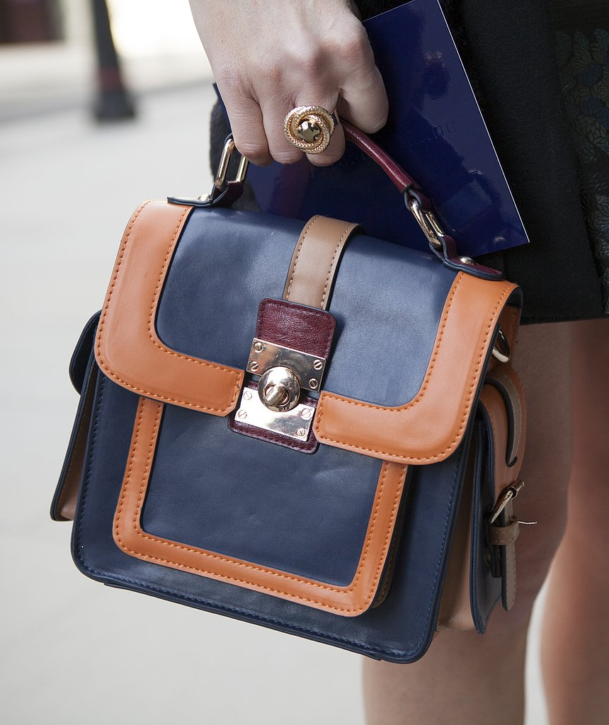A LFW attendee completes her look with a two-toned mini satchel.
