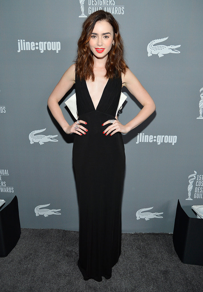 Lily Collins looked chic in black and white in her Paule Ka sleeveless V-neck gown and Brian Atwood pumps.