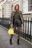 A tough-meets-sexy leather mini and leopard coat gave a rocker-glam vibe to this look.