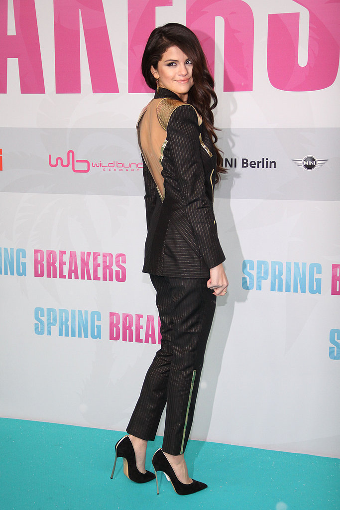Check out the unexpected back on Selena's suit.