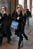 Bar Refaeli's all-black Milan look was given a jolt of color via her structured blue satchel.