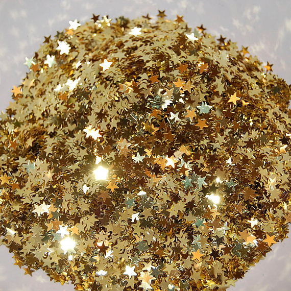 A sprinkling of this gold star confetti ($2) against a white tablecloth can mimic the effect of a shimmering table runner (for a fraction of the price!).