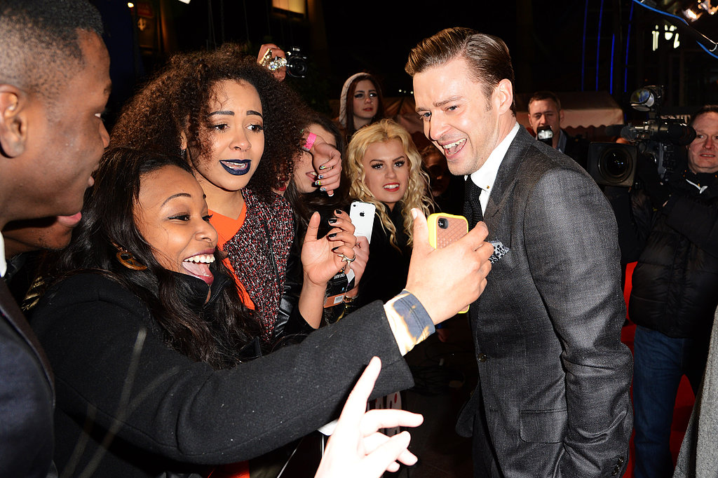 Justin Timberlake stopped to greet fans in his way inside the Brit Awards.