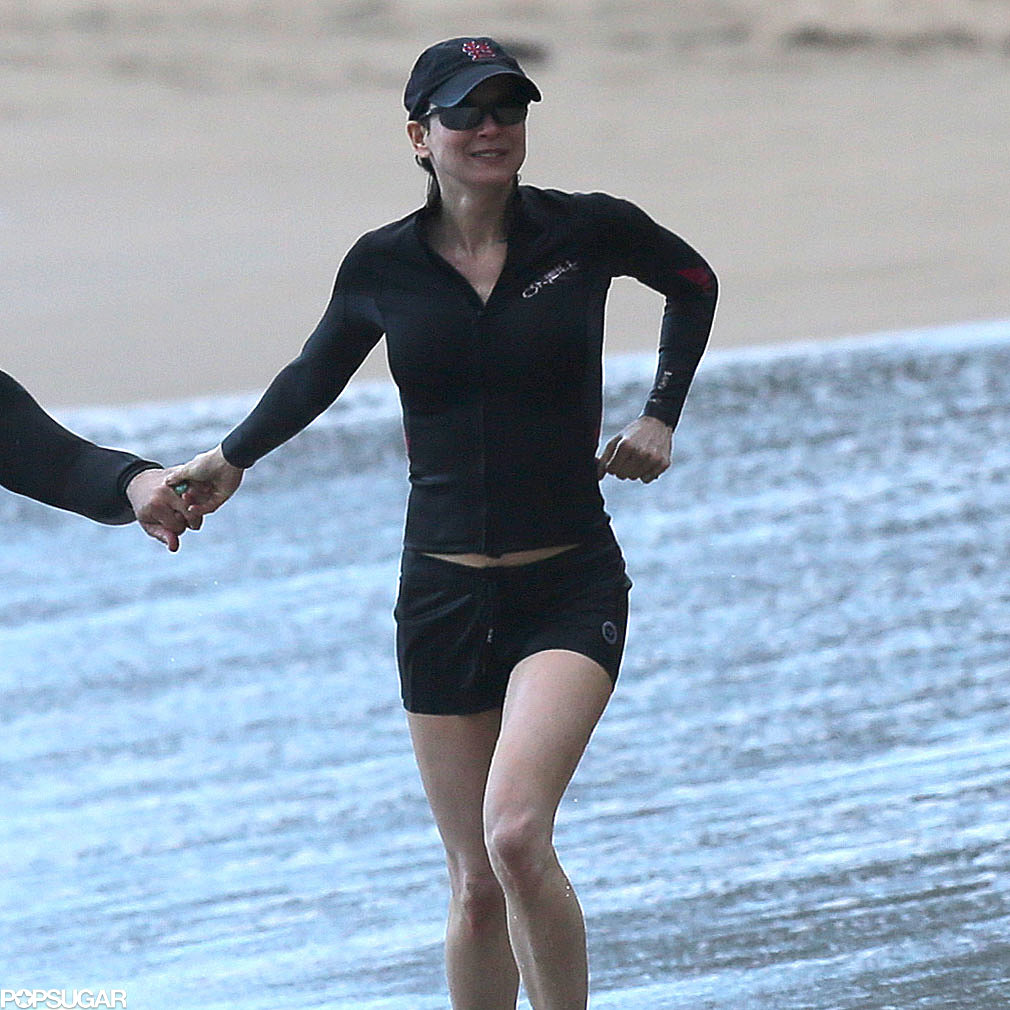 Renée Zellweger ran in the sand.