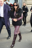 Salma Hayek worked a purple and black palette on her way to the Gucci show during Milan Fashion Week.