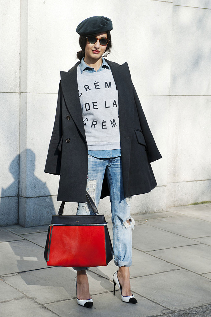 A statement sweatshirt gave denim on denim a trendier twist, while a luxe, fiery tote and black and white pumps added polish.