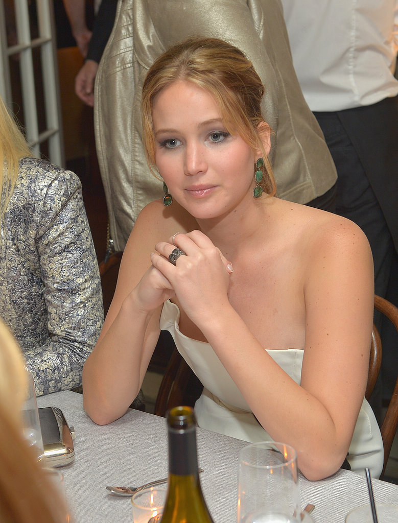 Jennifer Lawrence took her seat at a Vanity Fair bash for Silver Linings Playbook in LA on Wednesday night.