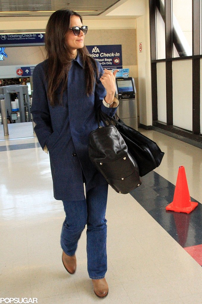 Katie Holmes wore a navy coat when she arrived at LAX on Wednesday.