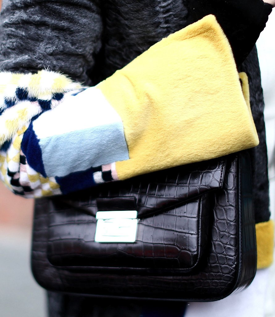 A black croc-embossed bag added an understated elegance to a multicolored fur jacket.