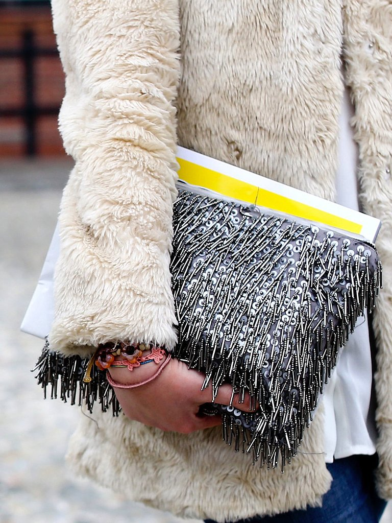 From the fur coat to the fringed clutch, this Fashion Week attendee was all about fun textures.