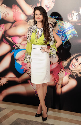 For the Spring Breakers photocall in Madrid, Selena Gomez sported a neon floral Dolce & Gabbana blouse with a white pencil skirt for a youthful take on the ladylike trend.