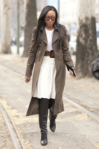 Shiona Turini made creamy white hues Winter-ready with a military-style coat and Alexander Wang's tough, sexy thigh-high boots.
