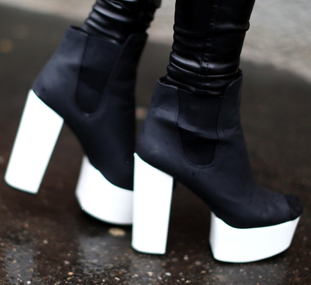 A Fashion Week attendee completed her look with fresh black-and-white ankle boots.