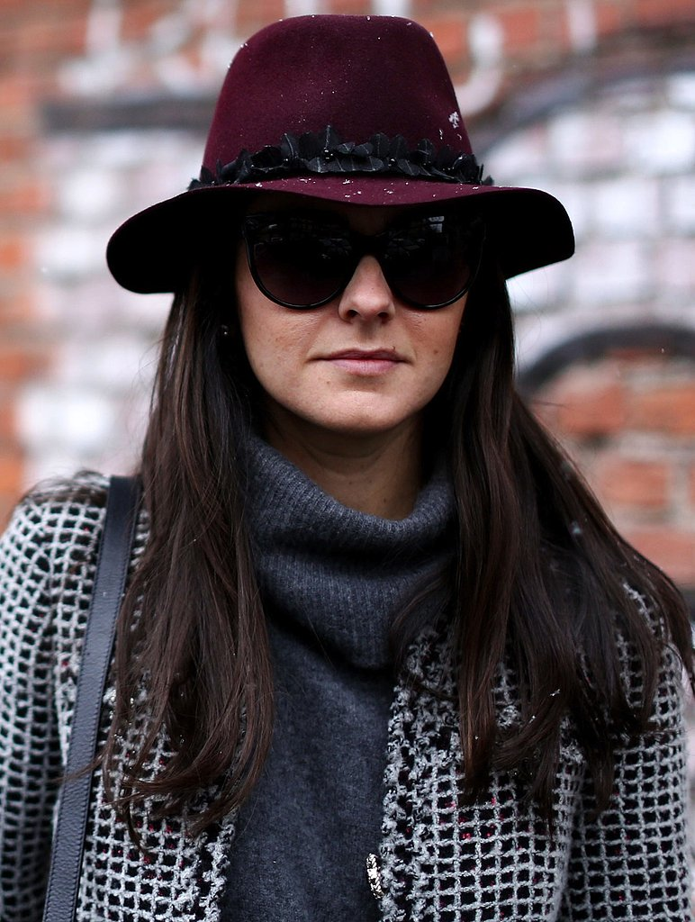 A maroon embellished fedora hat and dark shades provided stylish mystique to Winter layers.