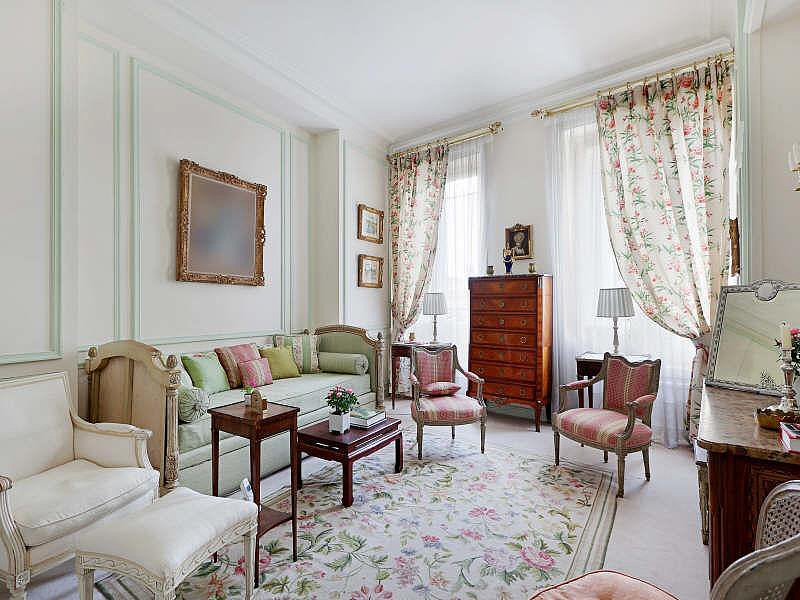 Thanks to floral patterns, classic wood furniture, and a consistent pink-and-green color palette, the sitting room has a simple, antique style. Source: Christie's Real Estate