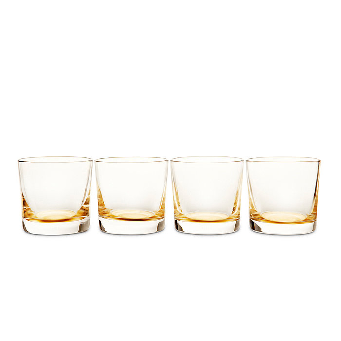 Sip in sophisticated style with these handblown crystal glasses ($280 for four), which feature a bright gold-leaf base.