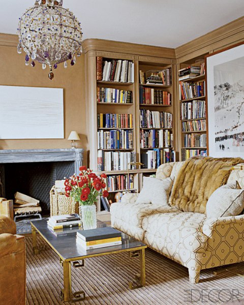 Cozy textures and simple patterns are offset by sleek, minimalist accents in Aerin's eclectic Manhattan library. Source: Elle Decor