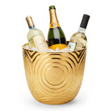 Have a bar cart in your library? Turn this gold-dipped circled bowl ($1,325) into an ice bucket for a cool, modern look.