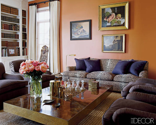 In her East Hampton home, Aerin added metallic accents to a punchy eggplant-and-tangerine color palette for a rich, sophisticated living room. Source: Elle Decor