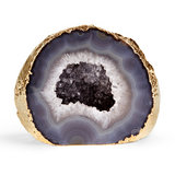 Add unique, earthy elegance to a side table or bookshelf with this gold-rimmed gray agate geode ($150).