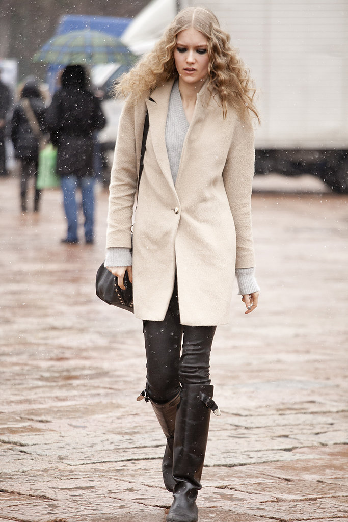 A sleek coat gave buckled boots a minimalist counterpoint.