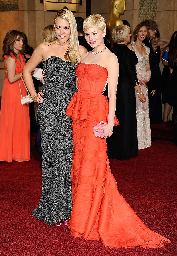 Best actress nominee Michelle Williams walked the red carpet with Busy Philipps for the Oscars in 2012.
