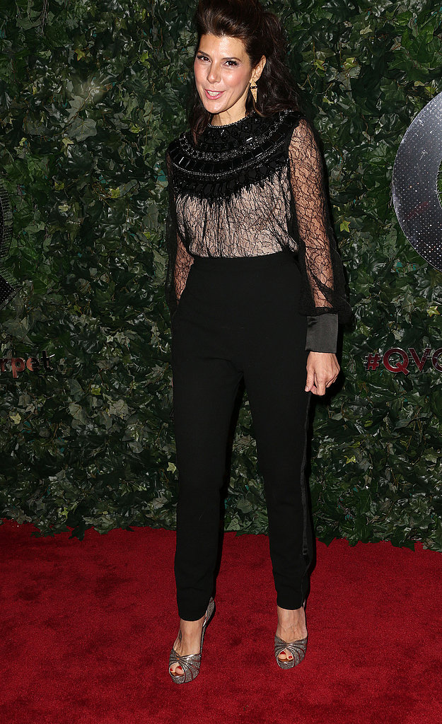 Marisa Tomei matched up a sheer lace blouse with black high-waist pants, then finished off with metallic peep-toes at the QVC Pre-Oscar event in LA.