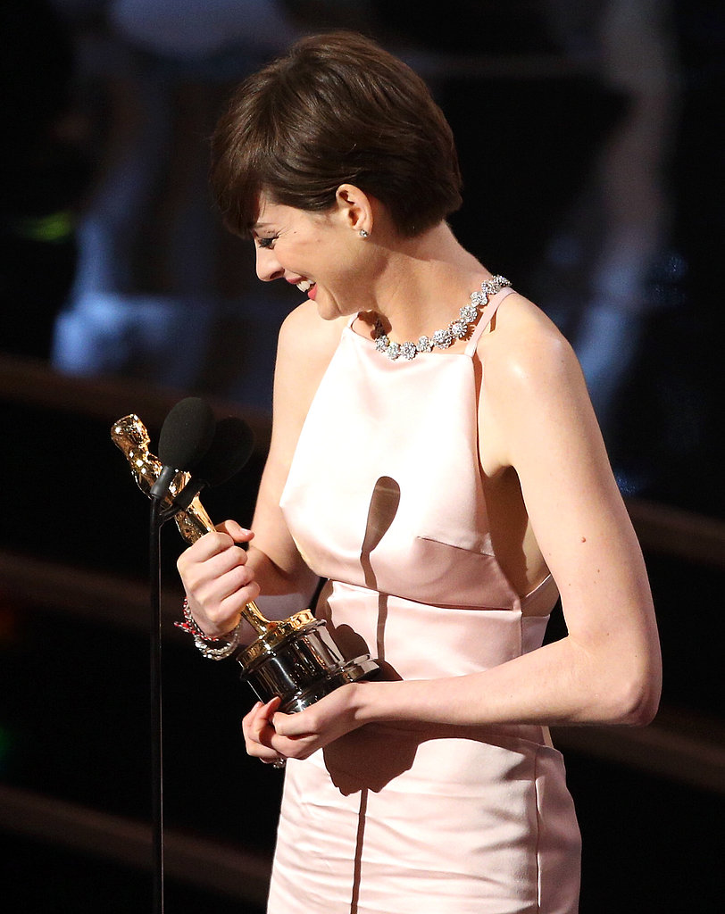 Anne Hathaway held on tight to her best supporting actress Oscar for Les Mis.