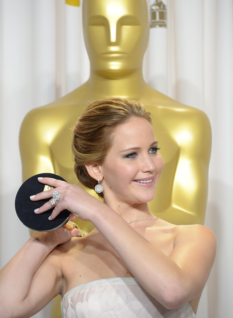 Jennifer Lawrence celebrated her best actress win backstage at the Oscars 2013.