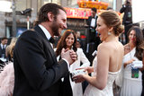 Bradley Cooper and Jennifer Lawrence laughed together on the red carpet at the Oscars on Sunday.