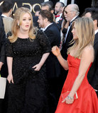 Adele and Jennifer Aniston on the red carpet at the Oscars 2013.